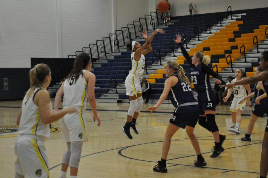 Lauren Harrell shoots a 3-pointer at the Midlo vs. James River basketball game.