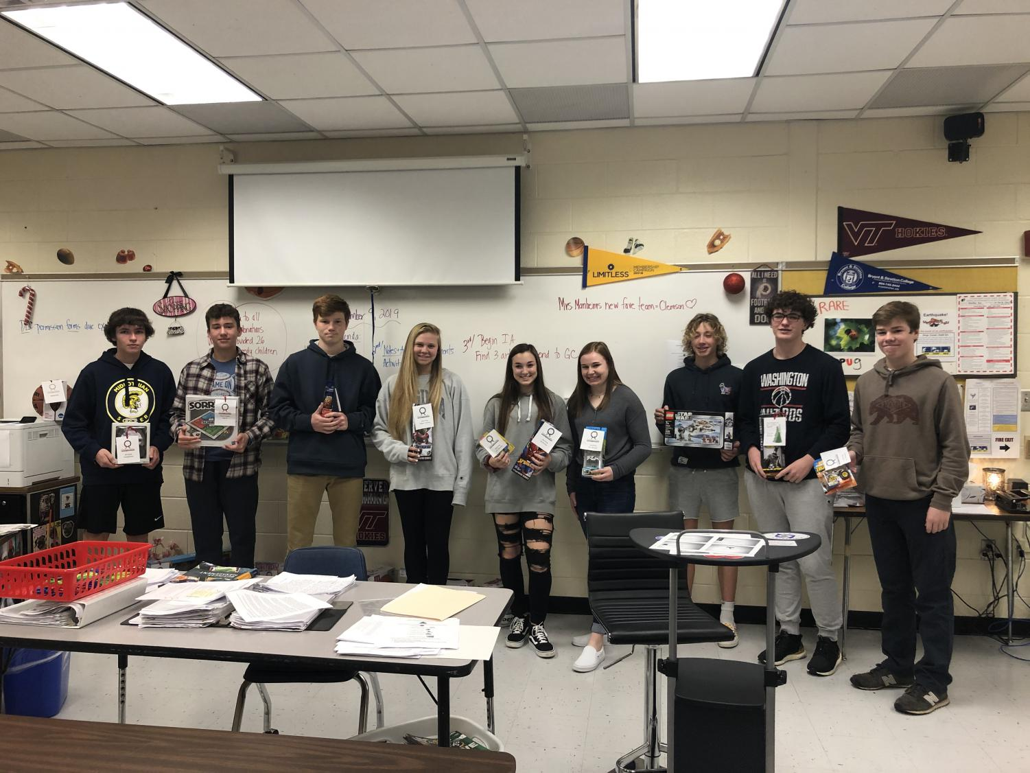 DECA members participate in the Christmas Mother holiday service project.