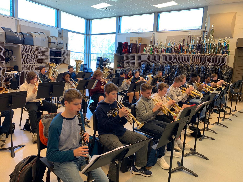 The Midlothian High School  concert ensemble warms up.