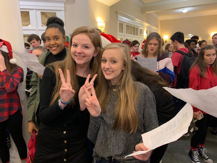 Kaija Taylor, Cassidy Shelton, and Whitley Glidewell prepare to sing Christmas carols to the residents of Spring Arbor.