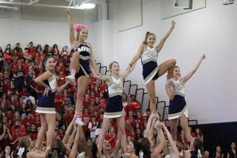 Cheerleaders Claire Horansky, Rachel Damico, Lisa Richburg, and Camden Wood earn All-Region honors for Competitive Cheer.