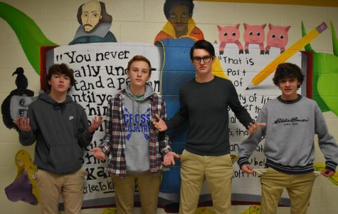 Will Acker, James Galloway, Bailey Carter, and Jack Pitts stand with pockets inside out, signifying the need for student discounts.