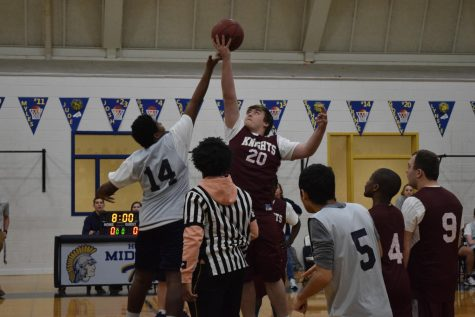 Trojans player Terence Reynolds jumps for the tip off in the Midlo vs. L.C Bird Skyhawks Medford basketball game.