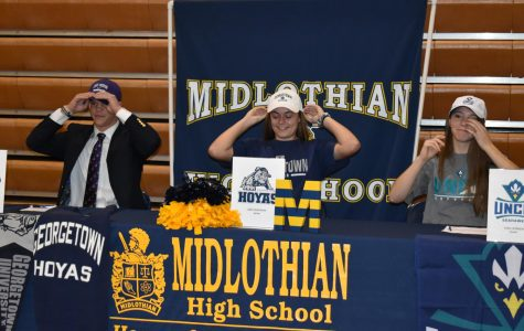 Christian Chambers, Erin Junkmann, and Emily Morrison don their college hats, marking their official commitment.