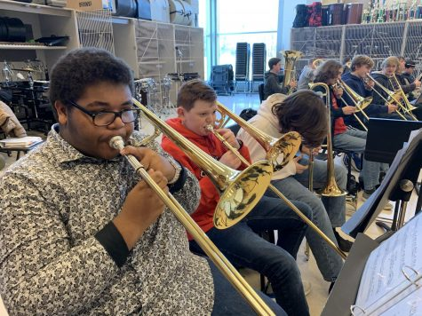 The low brass section of the Midlothian Symphonic Band practices their new music.