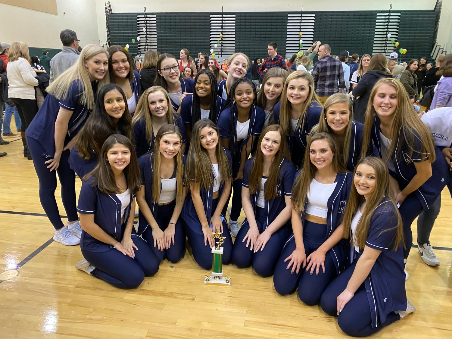The Midlo Trojanettes compete at the Kelly Green Invitational.