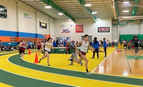 Junior Michael Wunderlich pushes during the 1000 meter run at the Pat Covas Invitational.