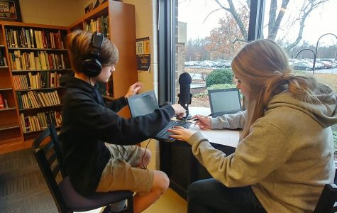 Publications students record their podcasts in the library.