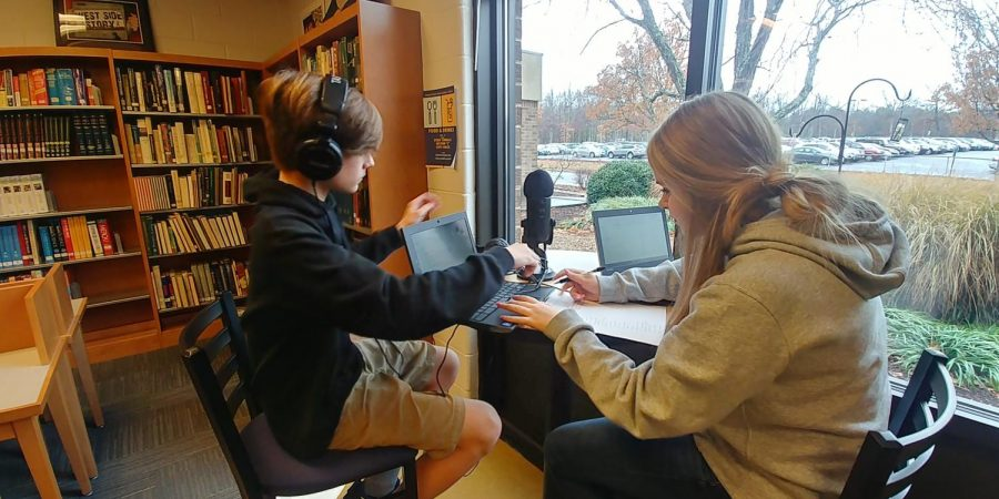 Publications+students+record+their+podcasts+in+the+library.