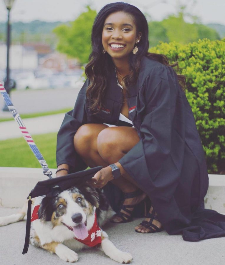 Ms. Lillian Ellick graduates from Radford University, overseen by her beloved dog Max.
