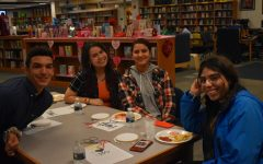 Students prepare to learn the art of cross-stitching at Midlo Library's Valentine's Day event.