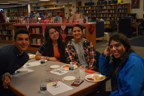 Students prepare to learn the art of cross-stitching at Midlo Library