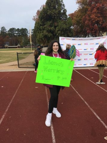 Noelia McCaffery volunteers at the ASK 5k in Richmond, VA to raise awareness for childhood cancer.