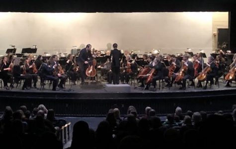 Julian Schwarz takes the stage at Midlothian High School as he prepares to perform his solo with the Richmond Symphony.