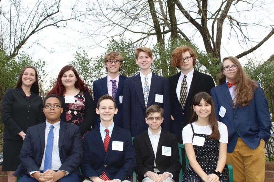 Mrs. Van Arsdale, Amelia Bryans, Paul Miller, Ryan Quiram, Aidan Leesburg, Sam Davis, Josh Williams, Gray Harcum, James Bobrovosky, and Isabella Vanderborg tackle political issues at the Model UN Conference at the Trinity Episcopal School.