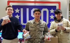 Freshman officers distribute goods to active duty members