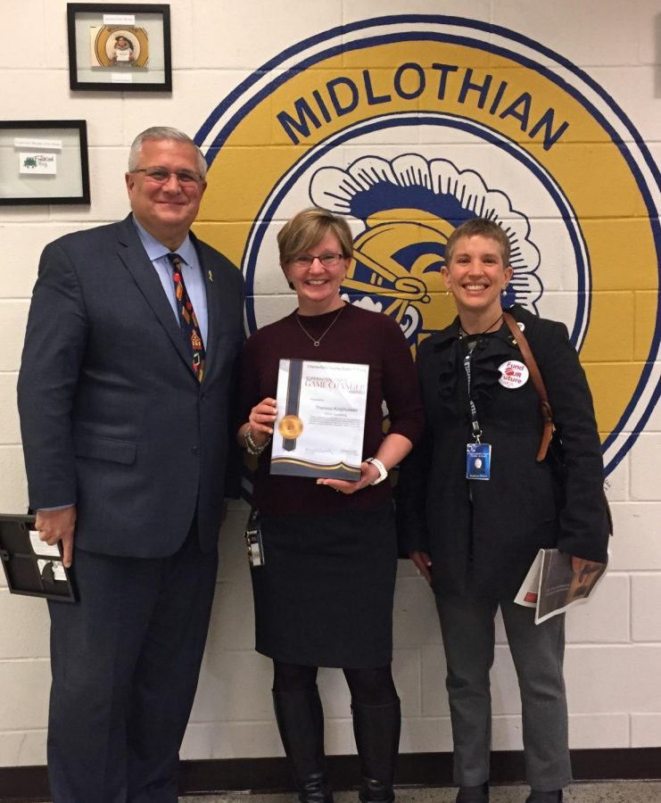 Mervin B. Daugherty and Kathryn Haines awarded Theresa Kniphuisen the CCPS Game Changer award at Midlothian High School.