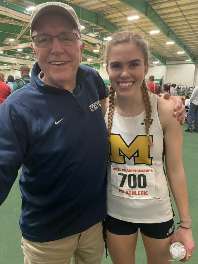 Coach Stan Morgan and Caroline Bowe celebrate Bowe's victory in the 1000 meter run at the VHSL Class 5 Indoor Track and Field State Championships.