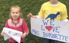 Jude Hill, joined by his little sister Wren, show their love for J.B. Watkins kindergarten teacher Mrs. Kathy Burnette at the Watkins staff parade on March 24, 2020.