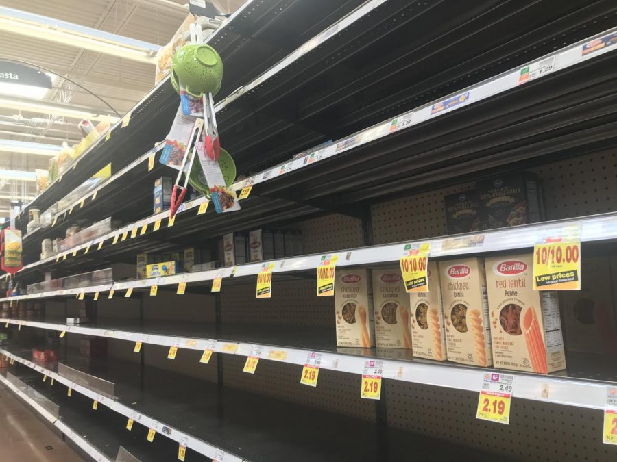 Grocery store shelves appear empty as citizens stock up during a time of self quarantine.