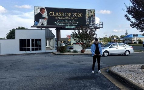 Adrian Cox celebrates his senior year while admiring his Class of 2020 billboard near Chesterfield Towne Center.