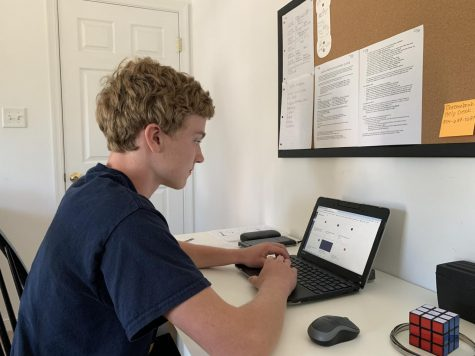 Freshman Adam Burke sets up an online work space as he begins high school in a virtual setting for the 2020 school year.