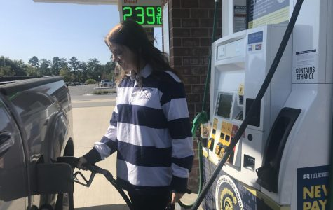 Kaitlyn Moore, a member of the Midlo Field Hockey team, supports the Midlo Boosters by filling her tank with gas from Pump 8 at the Charter Colony Shell station.