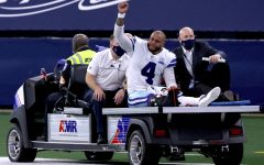 An emotional Prescott gets carted off the field after a devastating injury to the right leg.