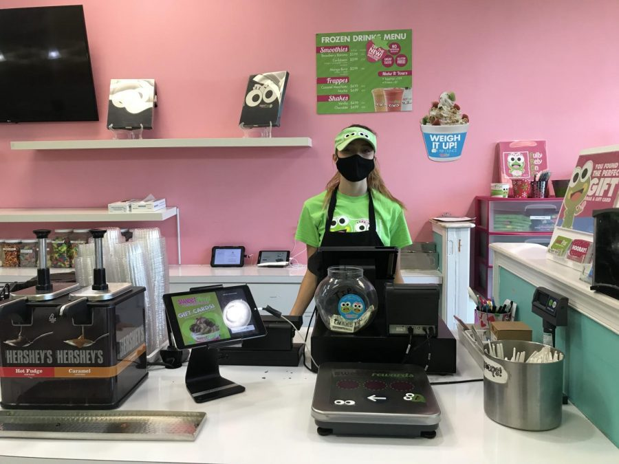 Victoria Melton prepares to serve customers at Sweet Frog.