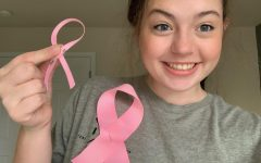 Lisa Witherow creates pink ribbons in honor of Breast Cancer Awareness Month.