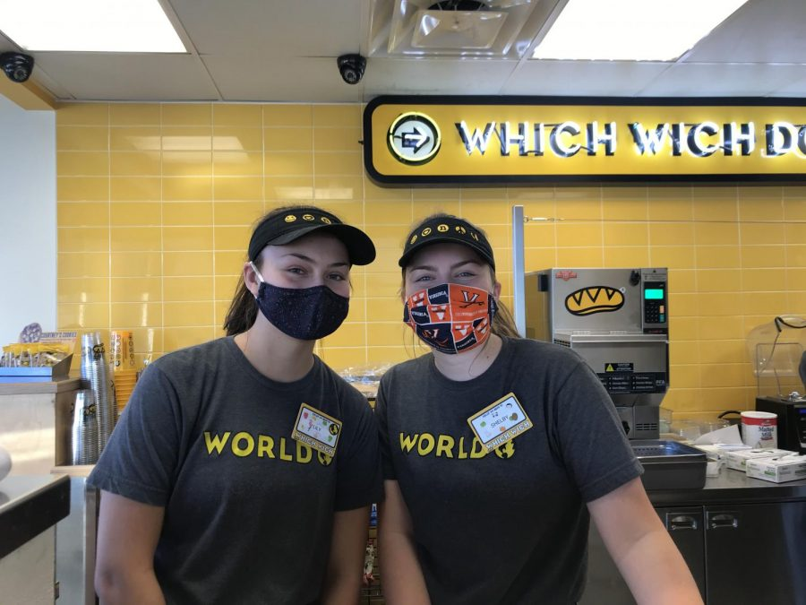 Seniors Lily DeBruycker and Shelby Harris take orders at the sandwich shop, Which Wich.