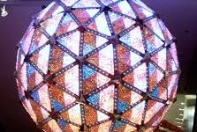 The illuminated ball makes its way to the ground during the countdown to the New Year.