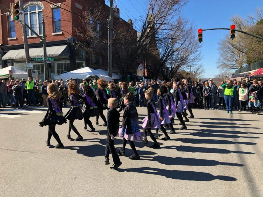 Kate Tabor and the Crossroads Irish Dance troupe parade through the Church Hill Irish Festival in 2019.