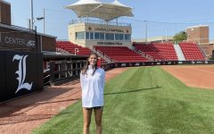 Cassie Grizzard feels at home on the Louisville University softball stadium.