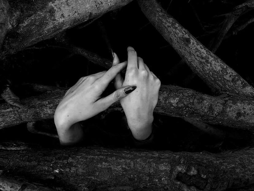 "Senior Libby Friedman won a Gold Key for her photograph with the title of ""Easing Into Darkness."" Libby found success in editing the image she took of her friend Abigail Van Eerden's hands. She looks forward to taking pictures as a hobby beyond high school and exploring digital media."