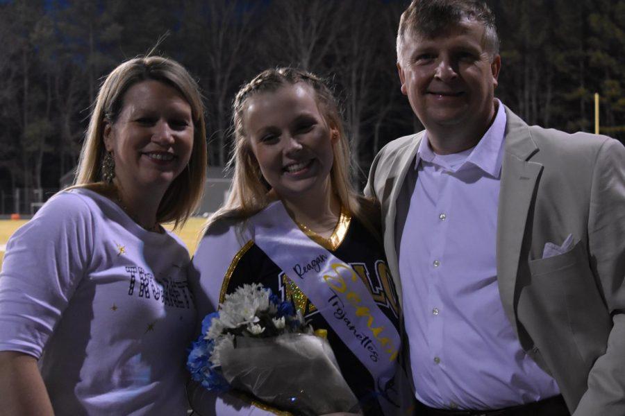 Senior Reagan Hatcher celebrates 2021 Dance Senior Night alongside her parents.