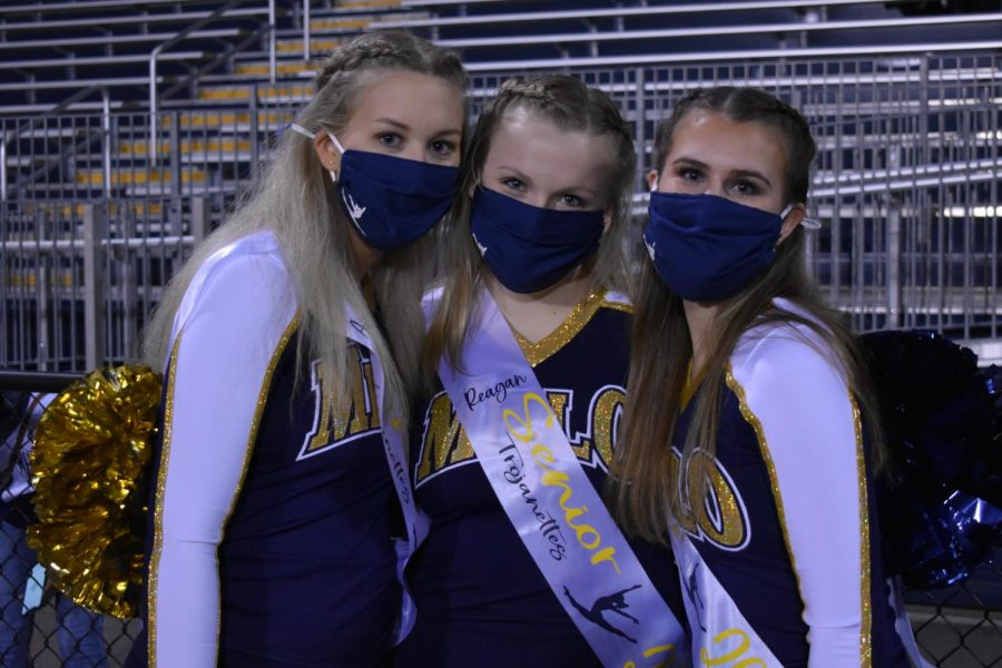 Ainsley Bryant, Reagan Hatcher, and Anna Sommardahl celebrate Dance Senior Night (pictured left to right).