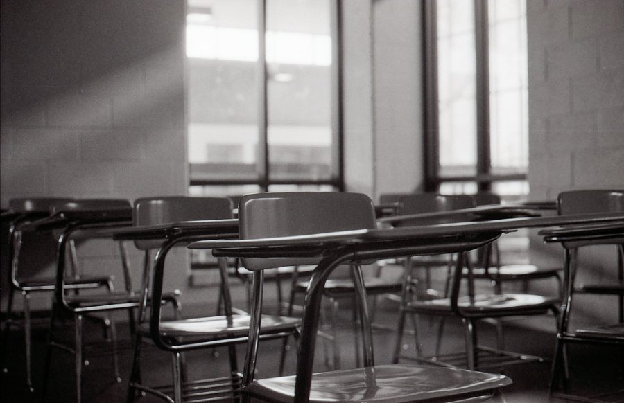 An empty classroom sits, waiting for students to return for in-person learning.