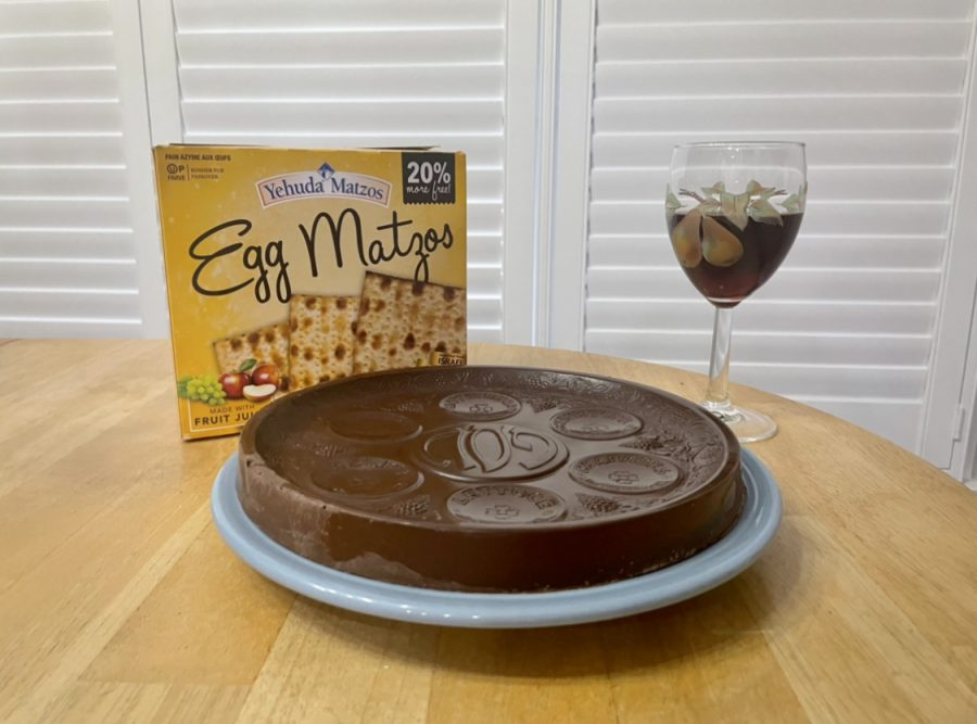 A traditional Passover meal has a seder plate, Matzo and grape juice to go along with the Haggadah.