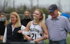 Charlie Wilkinson celebrates field hockey senior night with the support of her parents.