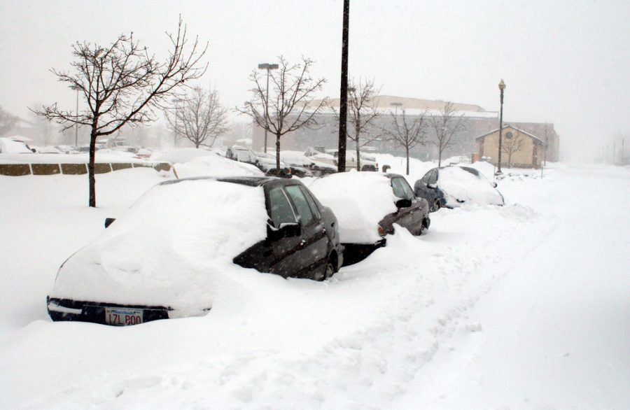 Three cars stand buried in snow outside of Bolling Air Force Base in the Nation's Capital.