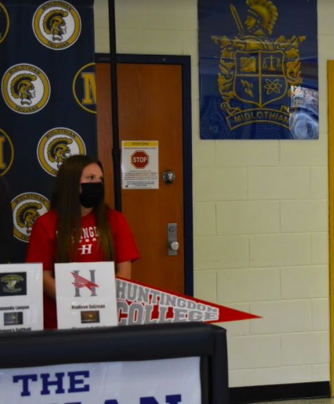 Senior Madison Salzman joins Midlo athletes in signing to play at the collegiate level.