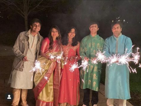 Sreeman Venigalla and his family light sparklers on a fun night for the IB Festival.
