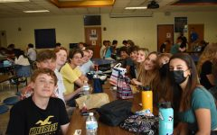 Midlo students catch up on the past year with one another over school lunch.