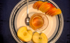 Members of the Jewish community take part in eating apples and honey during the annual celebration.