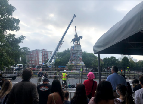Richmond residents watch in awe as the Robert E. Lee memorial is deconstructed.