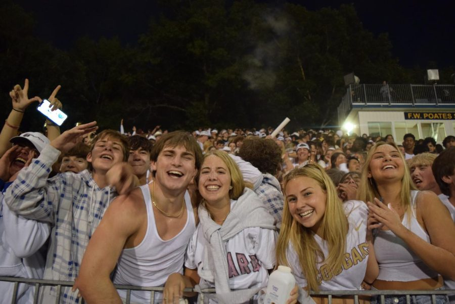 Midlo seniors enjoy their final moments together at the homecoming football game.